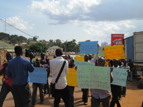Journalists and activists marched today towards the Daily Monitor.